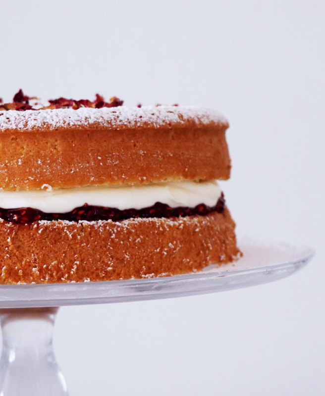 Jam and cream filled sponge cake